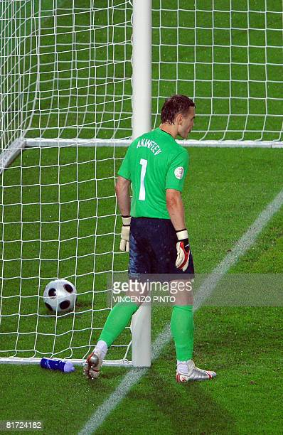 Russian goalkeeper Igor Akinfeev reacts after Spanish midfielder David Silva scored Spain's third goal during the Euro 2008 championships semifinal...