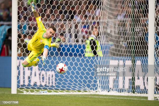 Russian goalkeeper Igor Akinfeev rejects a shot on target during the preliminary stage group A match between Russia and Portugal in the Spartak...