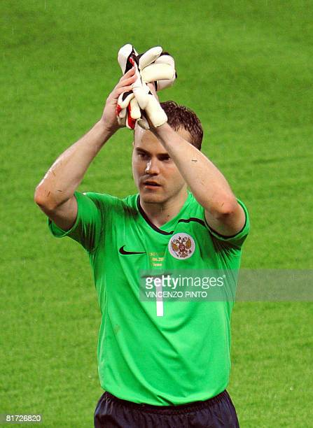 Russian goalkeeper Igor Akinfeev takes his gloves off at the end of the Euro 2008 championships semifinal football match Russia vs Spain on June 26...