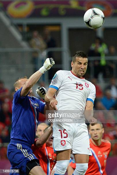 Russian goalkeeper Igor Akinfeev vies with Czech forward Milan Baros during the Euro 2012 football match Russia vs Czech Republic on June 8 2012 at...