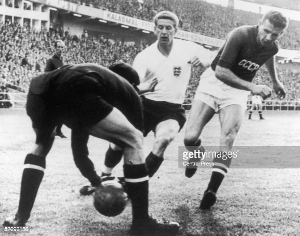 Russian goalkeeper Lev Yashin is charged by England player Derek Kevan during the EnglandRussia World Cup match at Gothenburg Sweden 9th June 1958