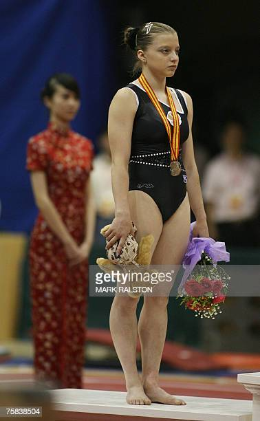 Russian gymnast Anna Pavlova stands with her silver medal after finishing second in the women's vaulting event at the finals of the FIG 2007 World...