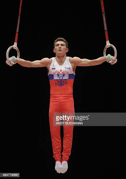 Russian gymnast David Belyavskiy competes on the rings during the Men's Team event final on the sixth day of the 2015 World Gymnastics Championship...
