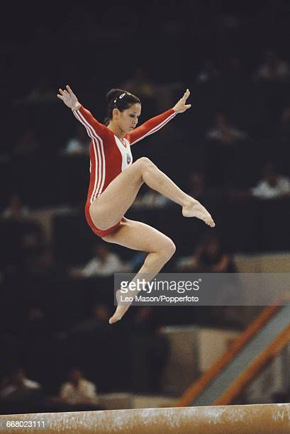 Russian gymnast Nellie Kim pictured in action competing for the Soviet Union on the balance beam during the final of the women's artistic team...