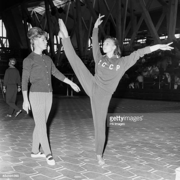Russian gymnasts Natalia Kutchinskaya practises under the watchful eye of Larissa Latynina the world's finest women's gymnast she was here with eight...