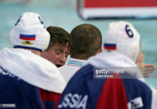 Russian Head Coach Alexander Kleymenov talks tactics during the Women's Bronze Medal Water Polo match between Russia and Hungary at the Melbourne...