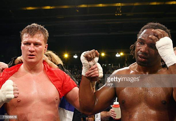 Russian heavyweight Aleksandr Povetkin holds up the arm of his opponent from the US, Chris Byrd after winning their IBF world championship fight in...