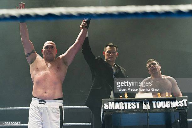 Russian heavyweight chessboxer Marat Shakhmanov realizes his loss against his Italian opponent Gianluca Sirca at a qualification fight for the World...
