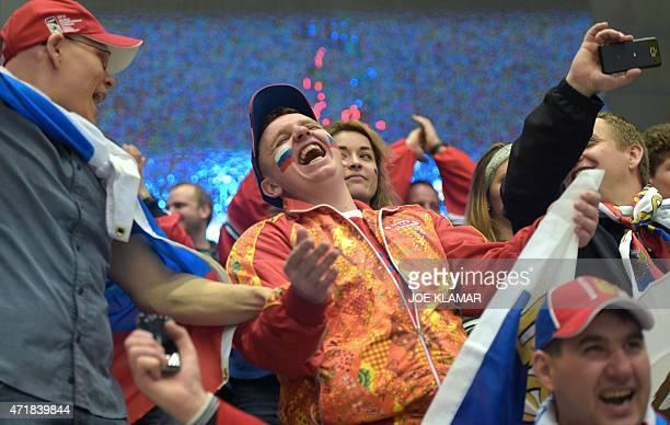 Russian hockey fans celebrate during the group B preliminary round ice hockey match Russia vs Norway of the IIHF International Ice Hockey World...