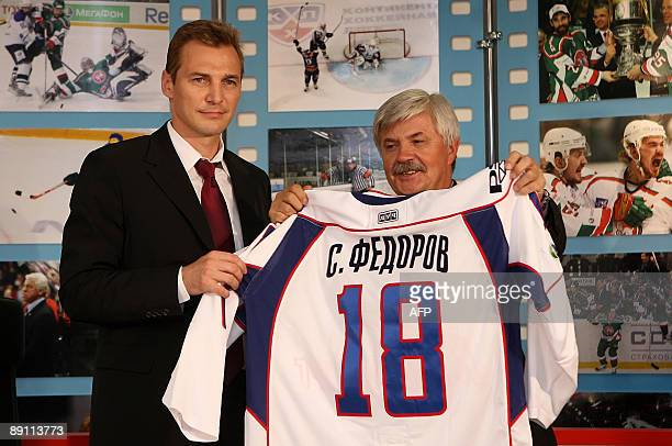 Russian hockey player Sergey Fedorov holds up his new jersey at a press conference in Moscow on July 20 2009 where he was unveiled as a member of the...