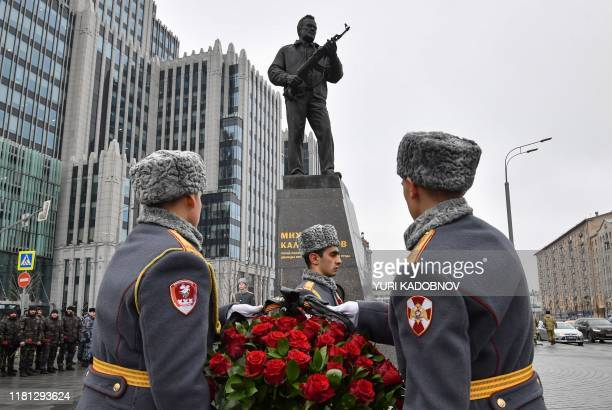 Russian honour guard soldiers attend a wreath laying ceremony at a statue of Mikhail Kalashnikov, the Russian inventor of the AK-47 assault rifle, in...