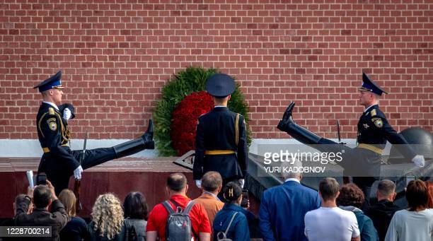 TOPSHOT Russian honour guards march during the changing of the guards ceremony at the Tomb of the Unknown Soldier in downtown Moscow on September 25...