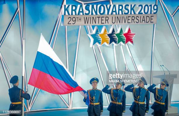 Russian honour guards raise the national flag during the opening ceremony for the 29th Winter Universiade at the Platinum Arena in Krasnoyarsk on...