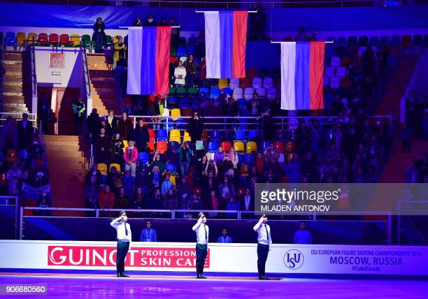 Russian honour guards salute during the flagraising ceremony for gold medallists Evgenia Tarasova and Vladimir Morozov of Russia silver medallists...
