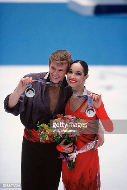 Russian ice dancers Anjelika Krylova and Oleg Ovsyannikov win the silver medal after their performance in White Ring during the 1998 Winter Olympics