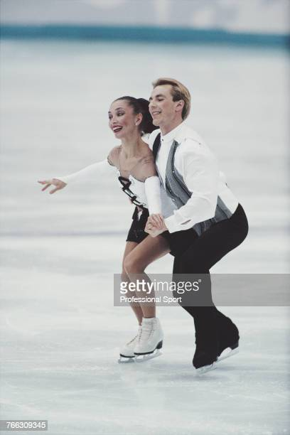 Russian ice dancers Maya Usova and Alexander Zhulin of the Russia team pictured together during competition to finish in 2nd place to win the silver...