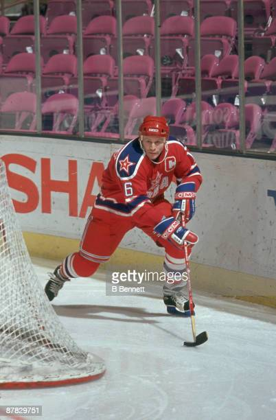 Russian ice hockey player Vladimir Konstantinov of CSKA Moscow skates with the puck behind the net during an exhibition game December 1990
