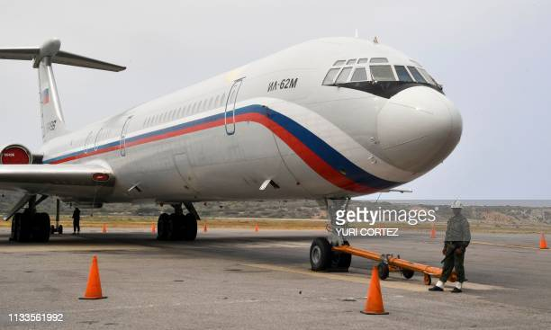 A Russian Ilyushin Il62M Air Force plane one of the two Russian military planes that arrived with troops and equipment to Venezuela last weekend sits...