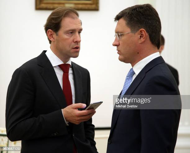 Russian Industry and Trade Minister Denis Manturov talks to Energy Minister Alexander Novak during RussianBulgarian talks at the Kremlin Moscow...