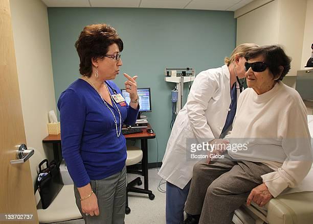 Russian interpreter Lilia Karapetyan left works with doctor Marion P Hogan and patient Viktoria Samvelyan She is an interpreter at Mt Auburn Hospital...