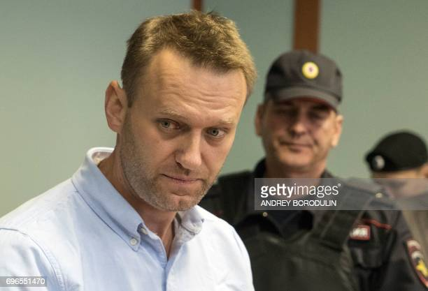 Russian jailed opposition leader Alexei Navalny arrives for a hearing at a court in Moscow on June 16, 2017. - Navalny has been sentenced to 30 days...
