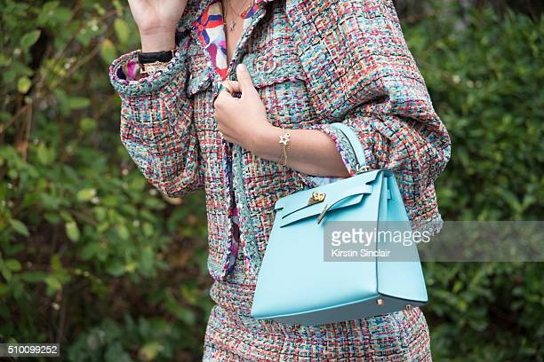 Russian Journalist for L'Officiel Ksenia Sobchak wears a Chanel suit and a Hermes bag on day 3 of Paris Haute Couture Fashion Week Spring/Summer 2016...