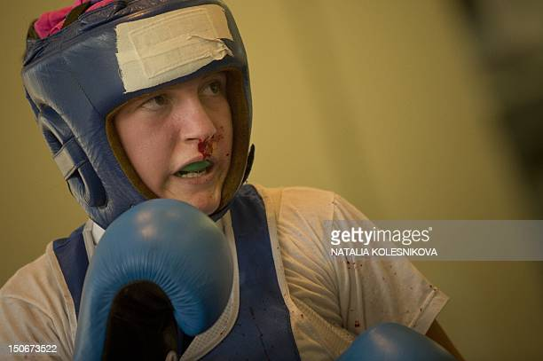 A Russian junior female boxer is bleeding during her bout at the AllRussian Women's Junior Boxing Tournament 'Olimpiyskiye Nadezhdy ' at a...