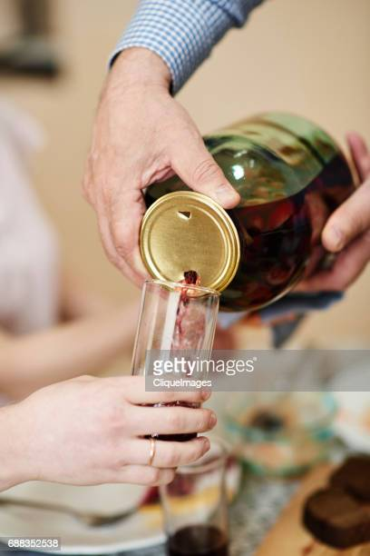 russian kompot being poured from jar - cliqueimages stockfoto's en -beelden