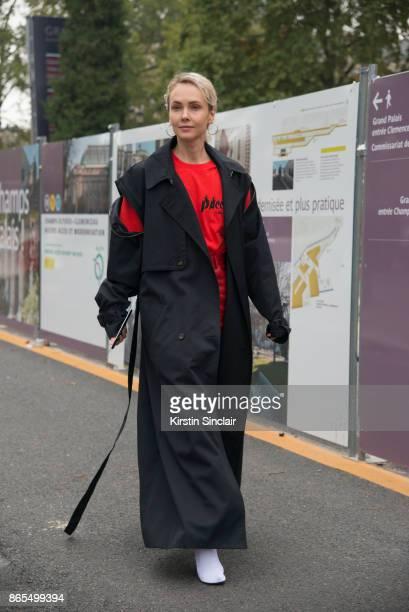 Russian Kuznetsky Most 20 concept store founder Olga Karput wears a Gosha Rubchinskiy tshirt and Balenciaga boots day 2 of Paris Womens Fashion Week...