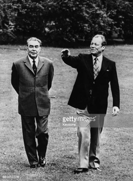 Russian leader Leonid Brezhnev walking with German Chancellor Willy Brandt in the latter's private garden during a visit to Bonn Germany 20th May 1973