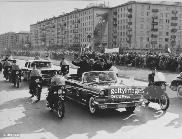 Russian leader Nikita Khrushchev takes Cuban leader Fidel Castro on a tour of Moscow during the latter's first visit to Russia 1st May 1963 Also in...