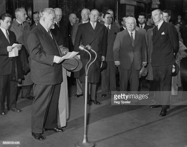 Russian leader Nikolai Bulganin makes his farewell speech in the presence of Nikita Khrushchev and British Prime Minister Anthony Eden before...