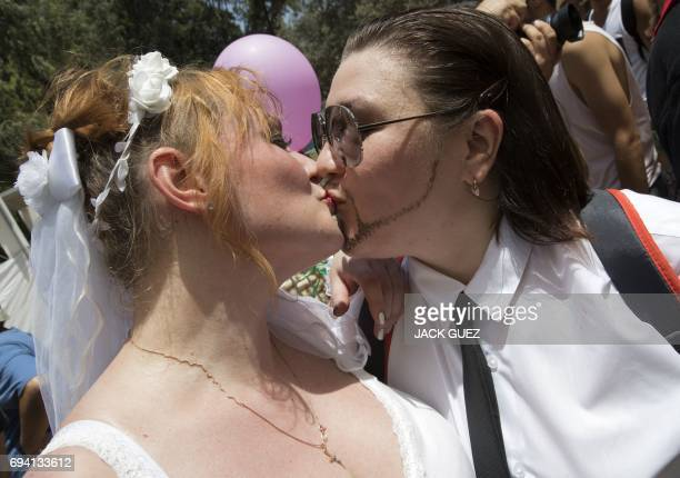 A Russian lesbian couple kiss at the annual Gay Pride parade in the Israeli city of Tel Aviv on June 9 2017 Tens of thousands of revellers from...