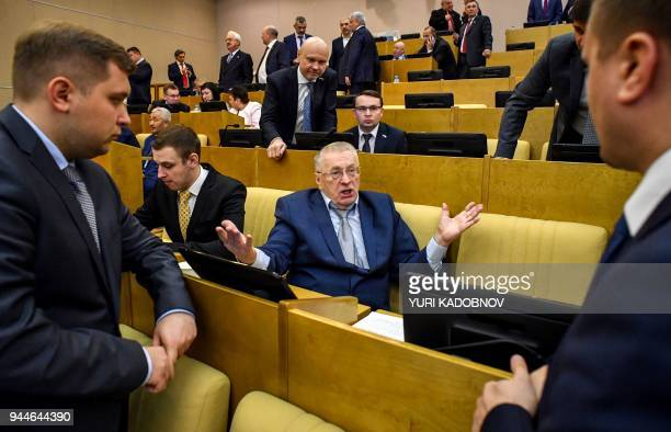 Russian Liberal Democratic Party leader Vladimir Zhirinovsky speaks with members of his faction before Prime Minister Dmitry Medvedev's speech at the...