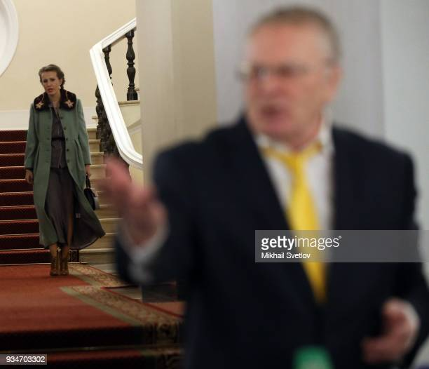 Russian liberal opposition leader Ksenia Sobchak looks on LDPR Party leader Vladimir Zhirinovsky after ther meeting of candidates for 2018...