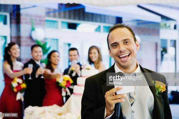 Russian man giving toast at wedding