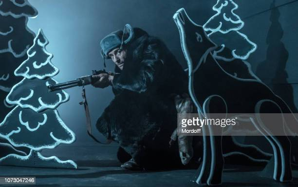 russian man is hunting in black tale forest - black wolf stock pictures, royalty-free photos & images