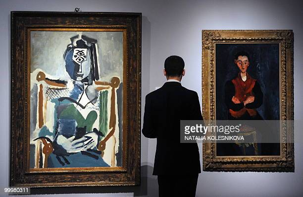 A Russian man looks at paintings by Chaim Soutine and Pablo Picasso on display in Moscow on May 19 2010 before their planned auction at Sotheby's AFP...