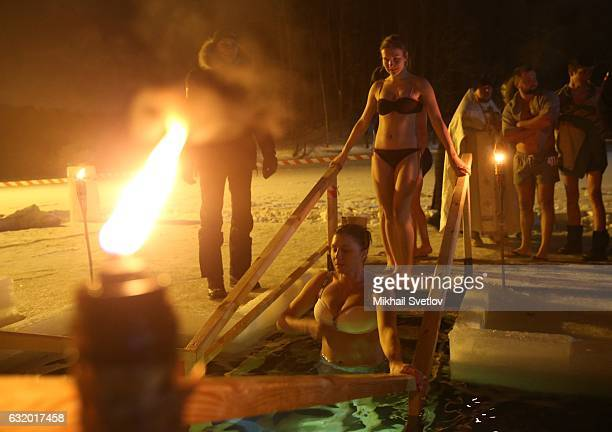 A Russian man takes an icy bath in 6 degrees Celsius temperatures while celebrating the Epiphany church holiday on January 19 2017 in the Lamishchevo...