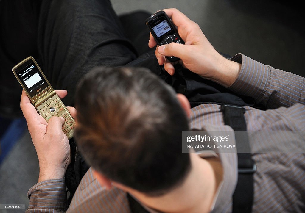 A Russian man transmits SMS messages sim : News Photo