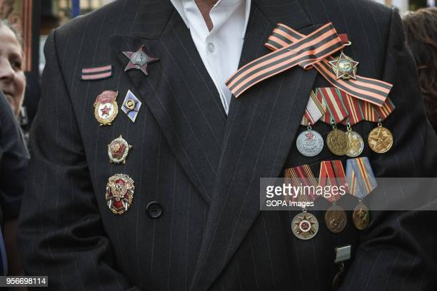 Russian man who lives in Greece seen wearing medals during The Immortal Regiment march Thousands of Russian citizens participated in the celebrations...