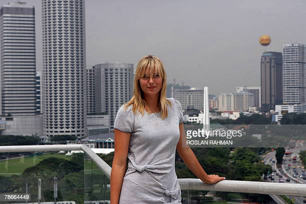 Russian Maria Sharapova one of the world top tennis players poses for a photo on the roof of a hotel in Singapore 28 December 2007 The Russian former...