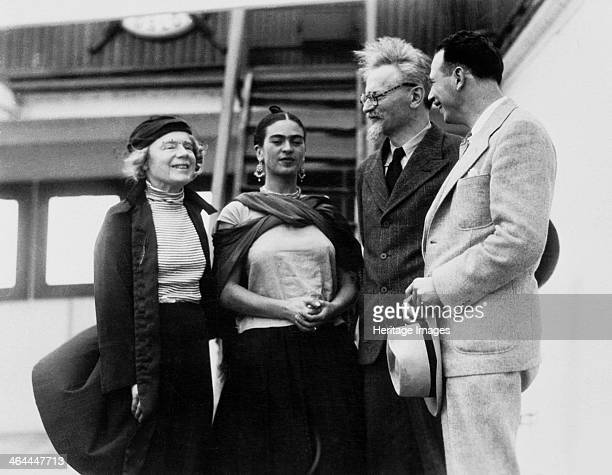 Russian Marxist revolutionary Leon Trotsky and his second wife Natalia Sedova are greeted by Mexican painter Frida Kahlo and Polishborn American...