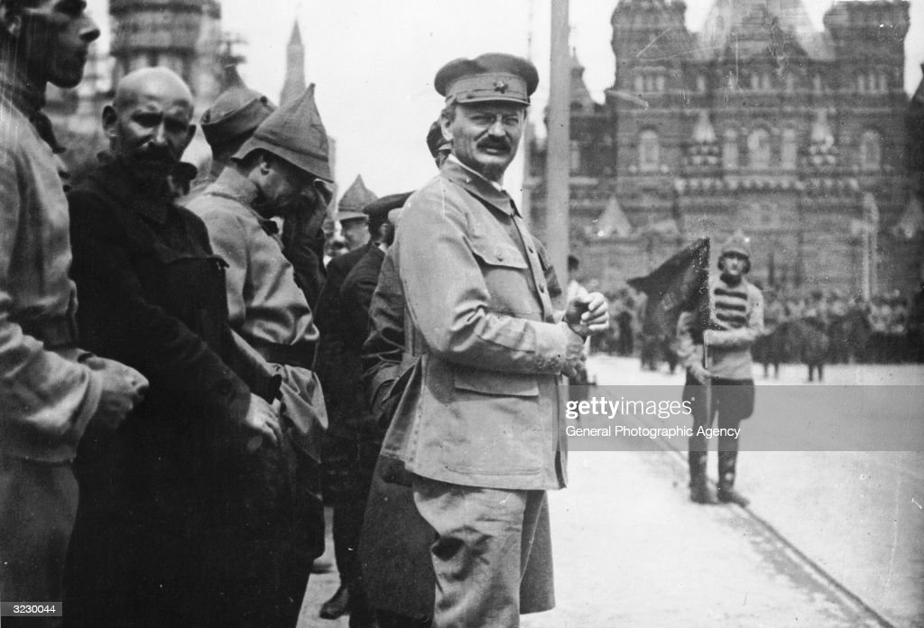 Russian Marxist theorist and Jewish revolutionary Leon Trotsky (1879 - 1940) attends a parade in Red Square, Moscow, as Lenin reviews his troops.