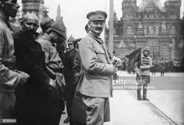 Russian Marxist theorist and Jewish revolutionary Leon Trotsky attends a parade in Red Square Moscow as Lenin reviews his troops