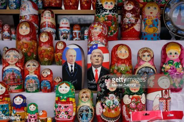 Russian Matryoshka dolls depicting Russian President Vladimir Putin and US President Donald Trump are seen on sale at Izmailovo flea market in Moscow...