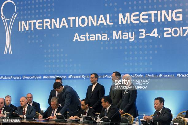 CORRECTION Russian mediator Alexander Lavrentiev Iranian deputy foreign minister Hossein Jaberi Ansari Kazakh Foreign Minister Kairat Abdrakhmanov...