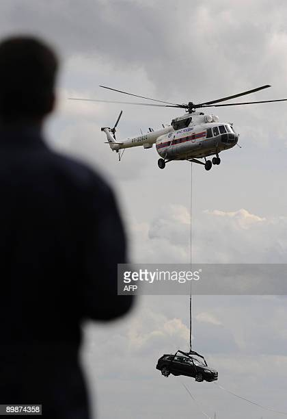 Russian Mi-8MB helicopter carries an automobile during the MAKS 2009 international aerospace show outside Moscow in Zhukovsky on August 19, 2009. The...