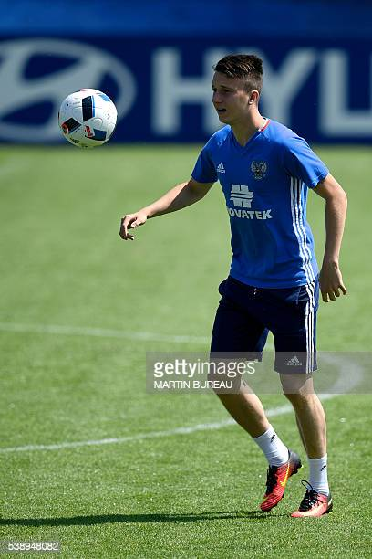 Russian midfielder Alexander Golovin practices during a training session on June 9 2016 in CroissysurSeine outside Paris on the eve of the beginning...