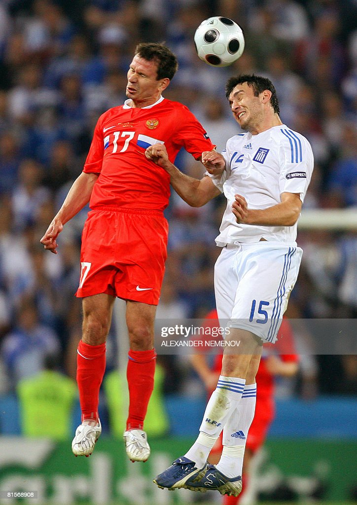 Russian midfielder Konstantin Zyryanov (L) and Greek defender Vassilis Torosidis jump for the ball during the Euro 2008 Championships group D football match Greece vs. Russia on June 14, 2008 at the Wals-Siezenheim stadium in Salzburg. Russia leads 1-0.